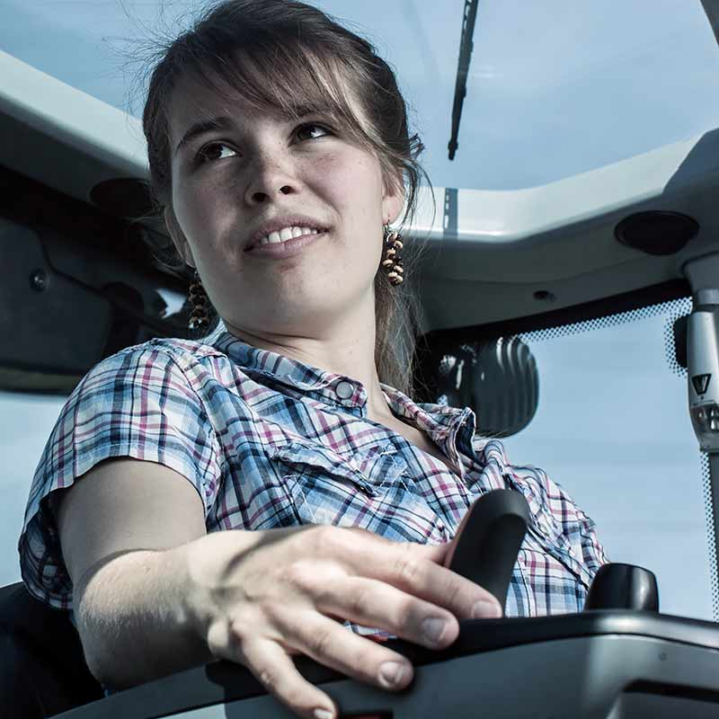 a girl inside valtra n4 series cabin